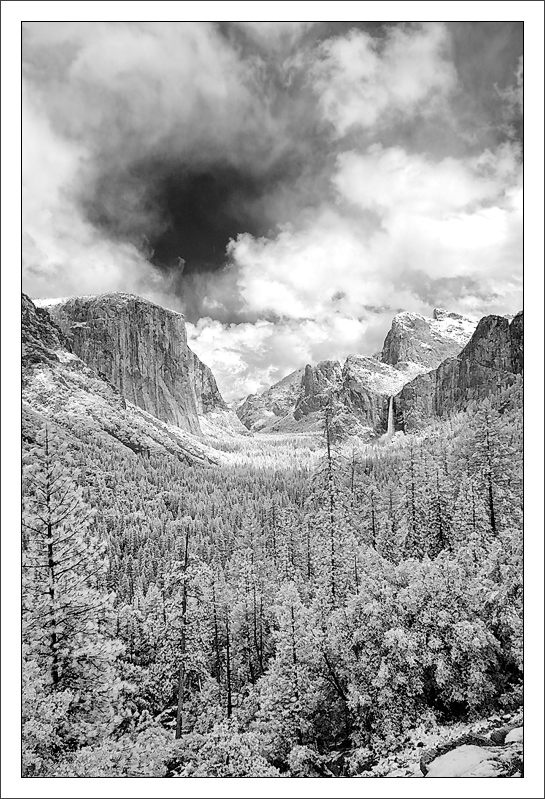 Passing Snow Storm Over Valley  A rare, late-spring snow storm makes its way across Yosemite Valley.  15-MAY-2011