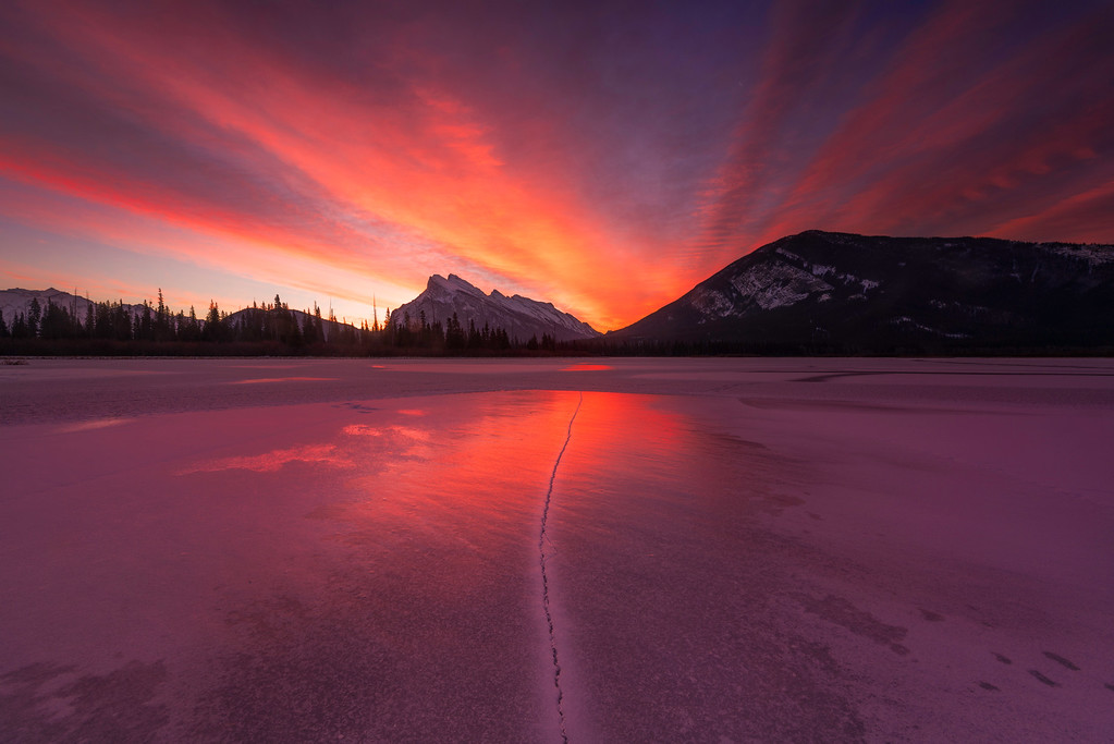 An incredible sunrise over Mount Rundle and the frozen Vermilion Lake of Banff National Park in November.