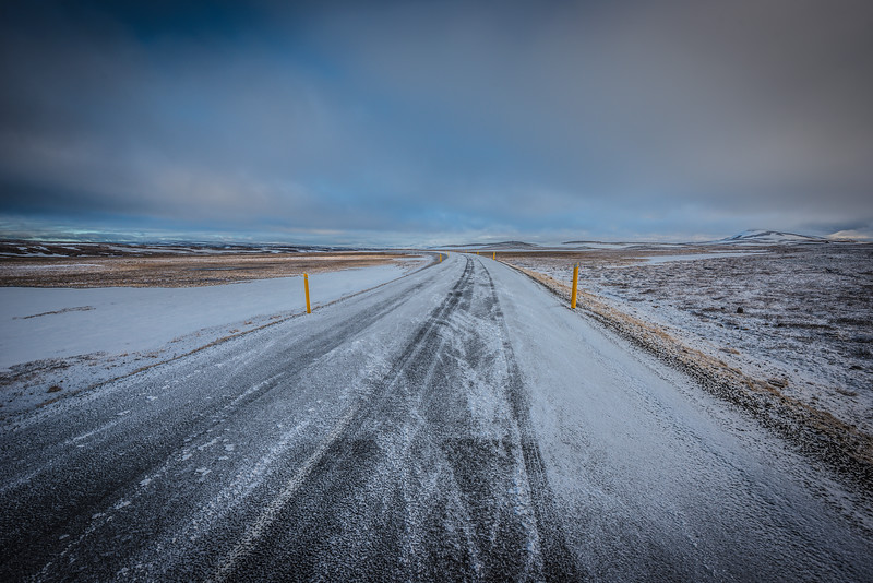 A road, in Iceland, covered with a light dusting of snow in June.