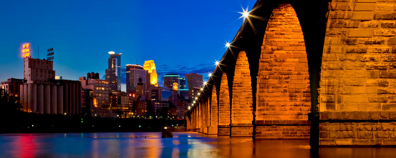 """Stone Arch"". Stone Arch Bridge is an iconic structure in Minneapolis. I found myself on the shoreline of the Mississippi river shooting this shot, while providing a tasty buffet to the hoards of mosquitoes that decided I made for a pretty good fast food option."