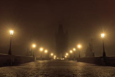 The Charles bridge in misty night