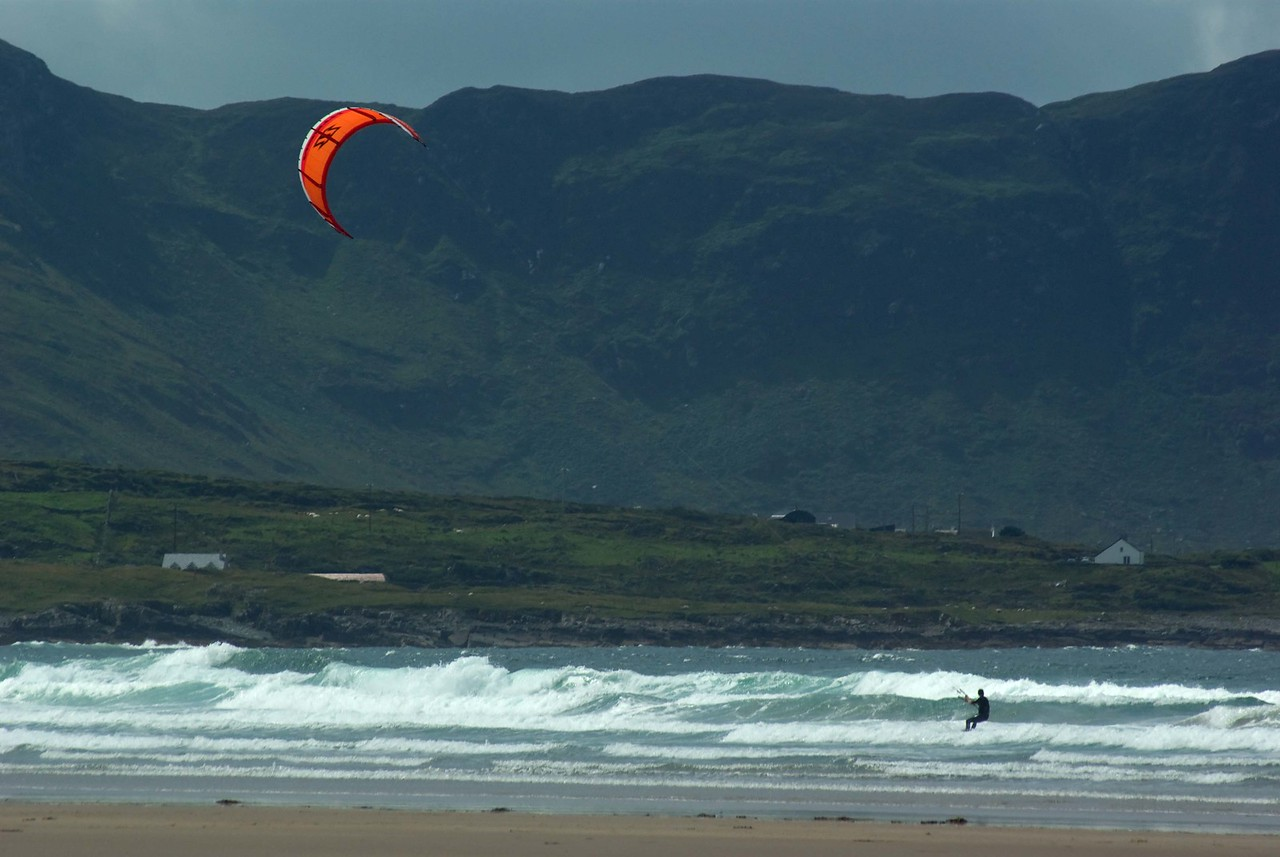 Kite-surfer, Tramore, Co. Donegal (I saw this guy arrive on the beach with his kite, and knew it would look pretty good with the back-drop. He took about 20 minutes to get organised, and I was ready to give up and leave when he finally entered the water and I got some great shots)