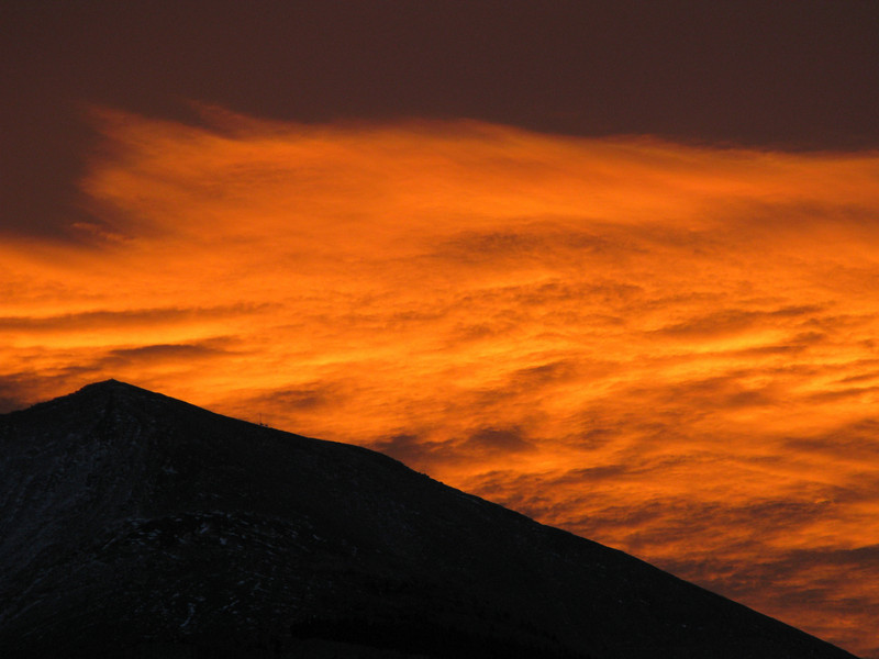 surreal light reflecting on a huge chinook cloud over Grotto Mountain