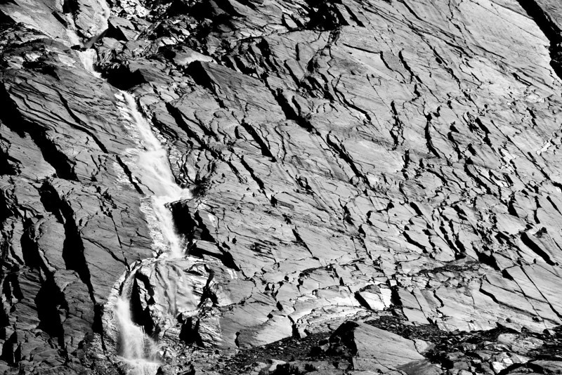 Water shapes the rock slab and leaves a signature