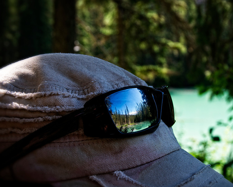 A reflection of the lake of the mirrored sunglasses of one of my fellow photographers during a photography field trip to Emerald Lake.