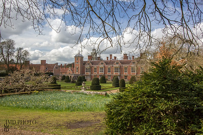 Millionaire Mansion. An English red brick country estate house with formal gardens.