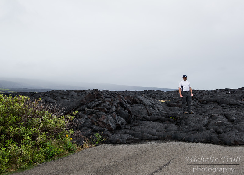 The small  white rectangle in the lava to Bruce's left is a sign stating 'ROAD CLOSED'.  This is where the road ended due to the lava flow of 2003.