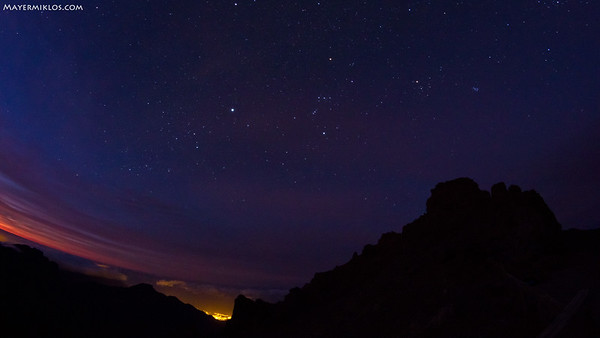 Sirius and Orion before sunrise above Caldera de Taburiente on La Palma island