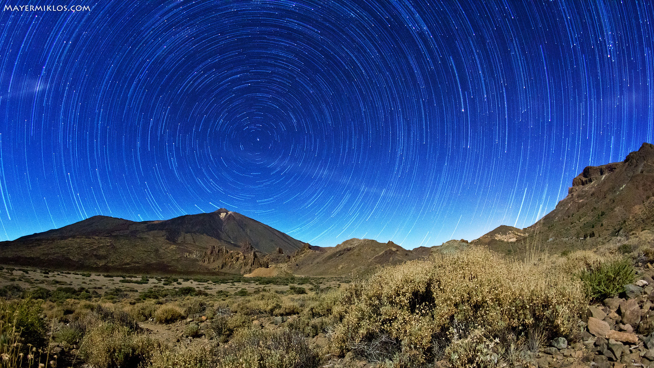 Rotation of the Earth is clearly visible when looking up the sky! Teide Mountain and Las Canadas national park. Combined from a stack of 120 pictures over approx. an hour