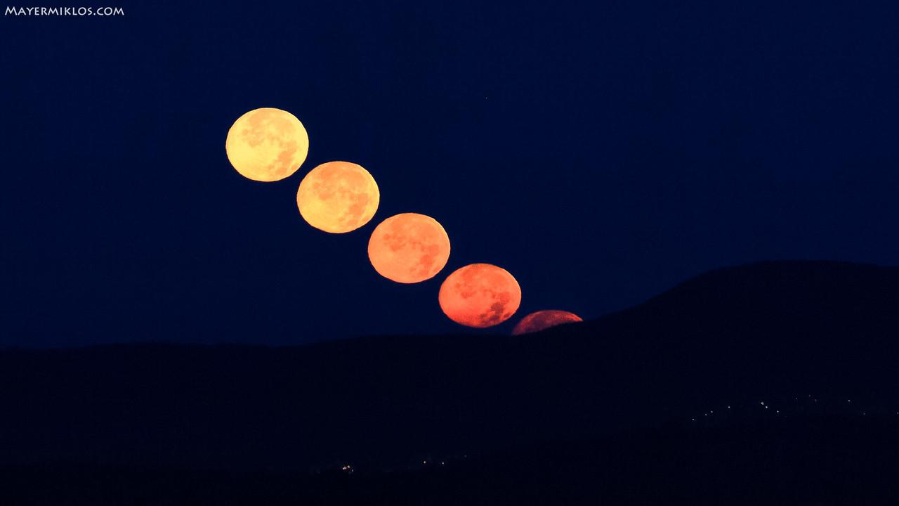 Moon setting over the hills near Budapest on October 22, 2010. This is a by-product of a timelapse sequence :) Each moon is separated about 140 seconds in time  Holdnyugta a budai hegyek fölött 2010. október 22-n. Ez egy timelapse sorozat mellékterméke :) Az egyes Holdak kb. 140 másodpercre vannak egymástól időben