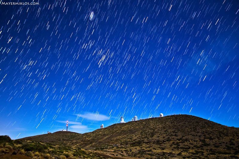 Startrails of Taurus and Orion over Teide Observatory in Tenerife