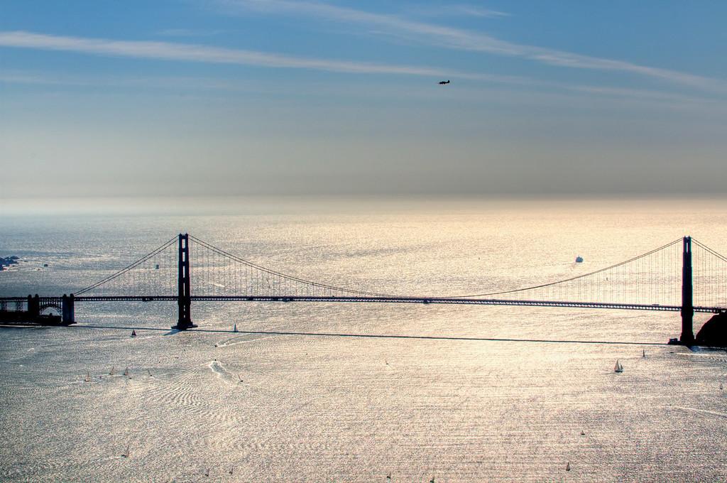 P-51 Mustang flying over the Golden Gate Bridge.