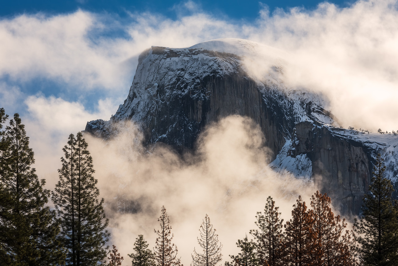 Half dome coveredin fog, Yosemite National Park