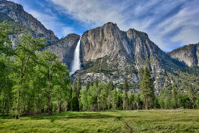 After a day of blank, grey skies, the clouds parted to add wispy drama over Upper Yosemite Fall.