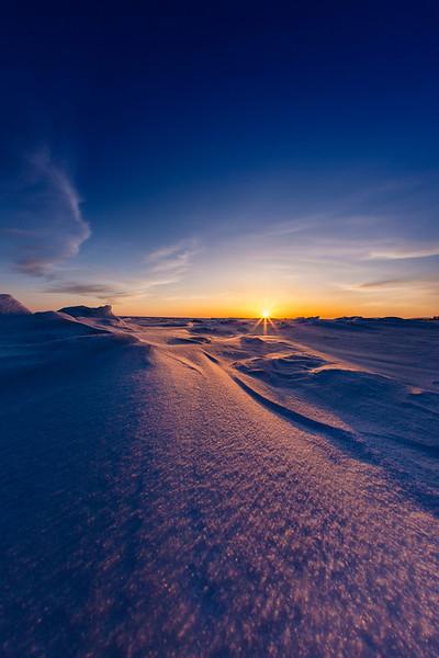 Sunset over the frozen Bering Sea, Alaska