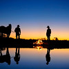 Kymberley and Randall at sunrise at the musterers camp, Anna Creek Cattle Station. South Australian Outback. Australia.