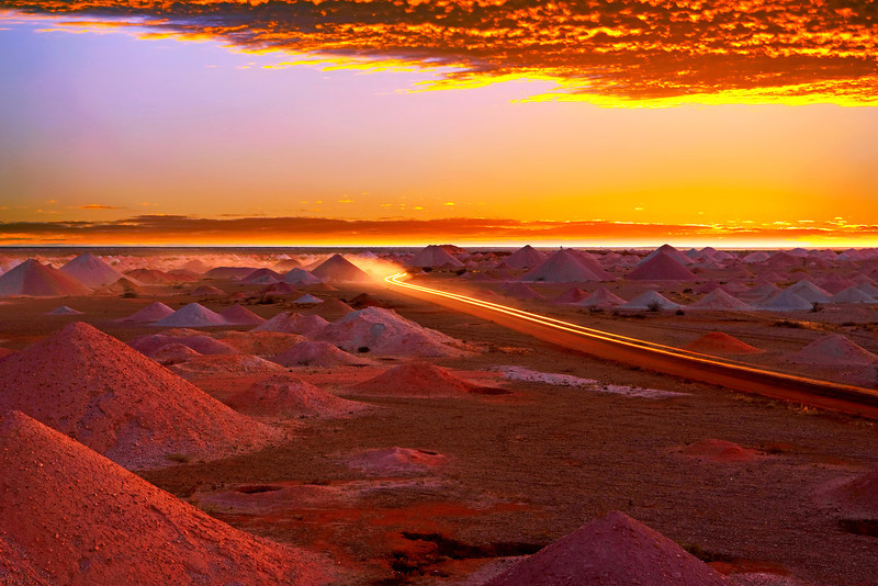 Outback panorama of driving through opal mines at sunset. Coober Pedy. South Australia.