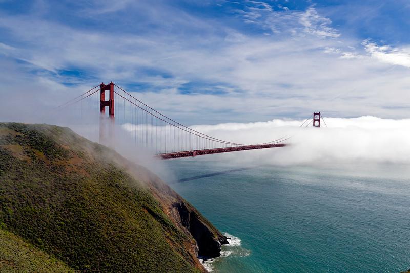 Golden gate bridge through the fog, San Francisco