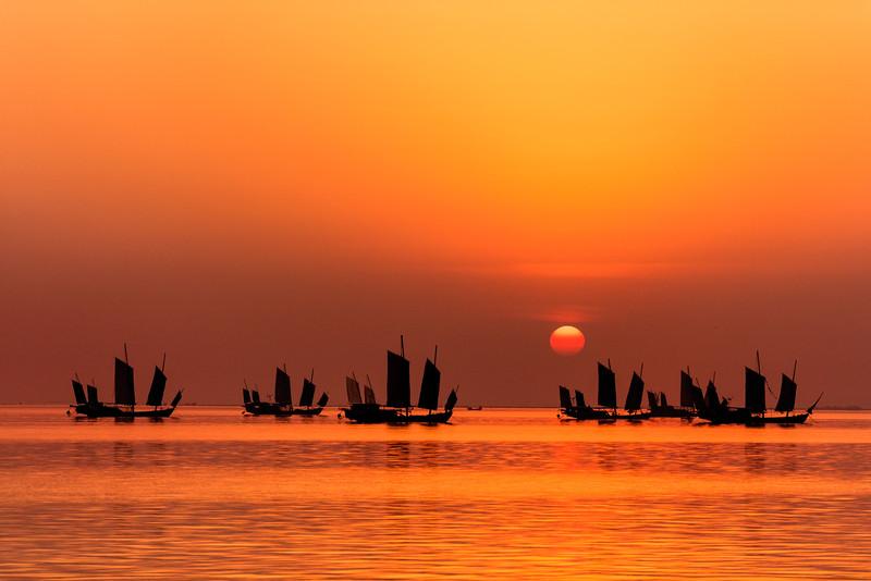 Fishing junks at sunrise on Lake Tai, Huzhou, China