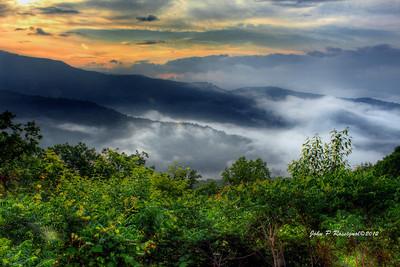 Sunrise on a cloudy, foggy morning on the Blue Ridge Parkway near Asheville NC