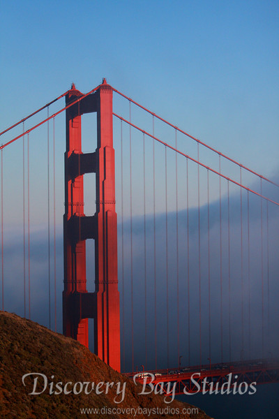 IMG_6434F Setting sun on San Francisco Golden Gate Bridge shrouded with fog.