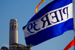IMG_6364F Pier 39 flag with Coit Tower in background