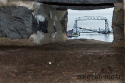 Duluth lift bridge framed by an opening in Enger Tower
