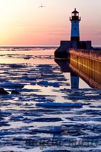 Duluth Harbor North Breakwater light broken reflection at sunrise