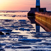 Duluth Harbor North Breakwater light broken reflection at sunrise