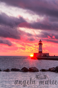 Sunrise by the lighthouse in Canal Park