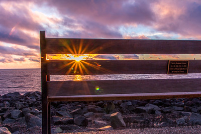 Sun rays through bench slats in Canal Park in Duluth