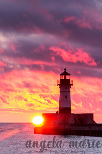 Sun rising by lighthouse in Canal Park