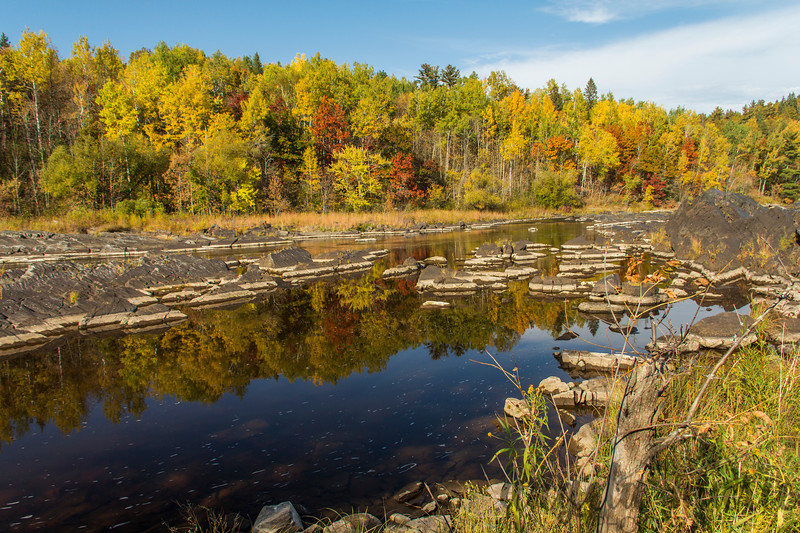 Fall colors reflected in the St. Louis River at Jay Cooke State Park near Carlton, Minnesota