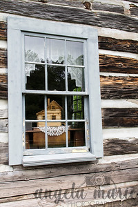 Model House through a window at the Old Victoria Restoration Site in Rockland, Michigan
