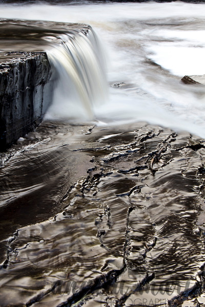Closeup of water flowing in the Presque Isle River, Michigan