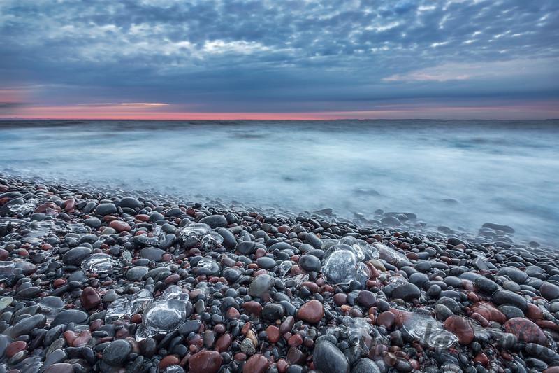 Iced Rocks At Sunrise