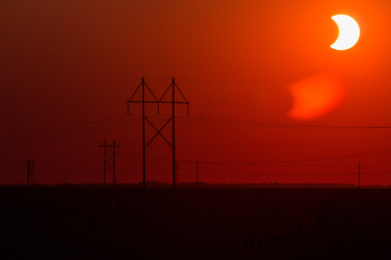 Solar eclipse setting by power lines on May 20, 2012. Taken in Rendezvous Park in West Fargo, ND