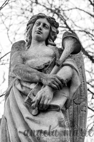 A closeup of the angel on a headstone at St. Marx Cemetery.