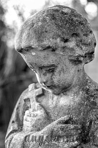 Close up of Crying Headstone at St. Marx Cemetery