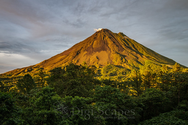 Golden light caressing the Arenal Volcano in Arenal Volcano National Park, Costa Rica
