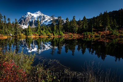 Mt Shuksan reflecting in the water of Highwood Lake in the Mt. Baker-Snoqualmie National Forest