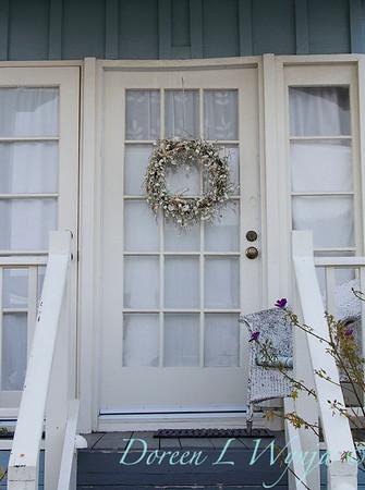 Seashell wreath hanging on a front door_2339