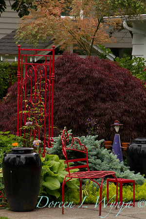 Red wrought iron garden accents_5483
