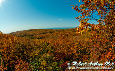 Hiker's view of blazing autumn foliage and Lake Superior from the Summit Creek Scenic Area within Porcupine Mountains Wilderness State Park (USA MI Ontonagon)