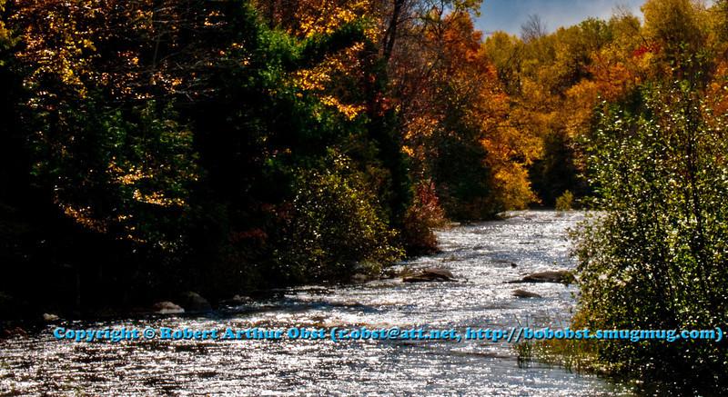 Diamonds of sunlight and crimson autumn foliage embrace sparkling Sherry Rapids along the wild Wolf River (USA WI White Lake)
