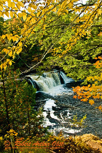 Autumn frames Presque Isle River's Manabezho Falls by North Country Trail in Porcupine Mountains Wilderness State Park (USA MI Ontonagon)