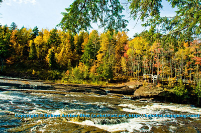 Autumn foliage and rapids guard the entrance to Presque Isle River's Manido Falls within Porcupine Mountains Wilderness State Park (USA MI Ontonagon)