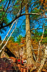 Autumn beauty and blue skies frame hikers and photographers on Balanced Rock Trail within Devils Lake State Park (USA WI Baraboo)