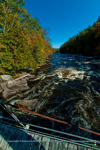 Blue skies and autumn colors frame Boy Scouts Rapids on the wild Wolf River near White Lake (USA WI White Lake)