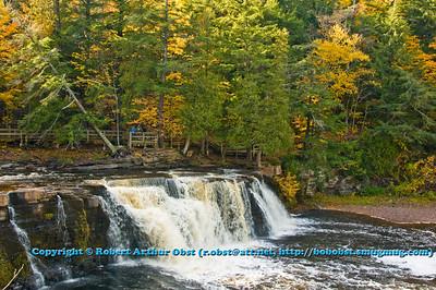 Autumn color surrounds Presque Isle River's Manabezho Falls within Porcupine Mountains Wilderness State Park (USA MI Ontonagon)